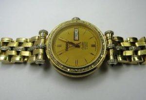 Laikrodis Nr.1 (iš geltono aukso, inkrustuotas juodais ir baltais briliantais)
