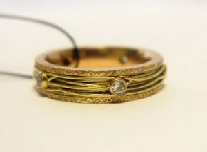 Vestuviniai žiedai Nr.86 (iš geltono aukso, puošti brangakmeniais)